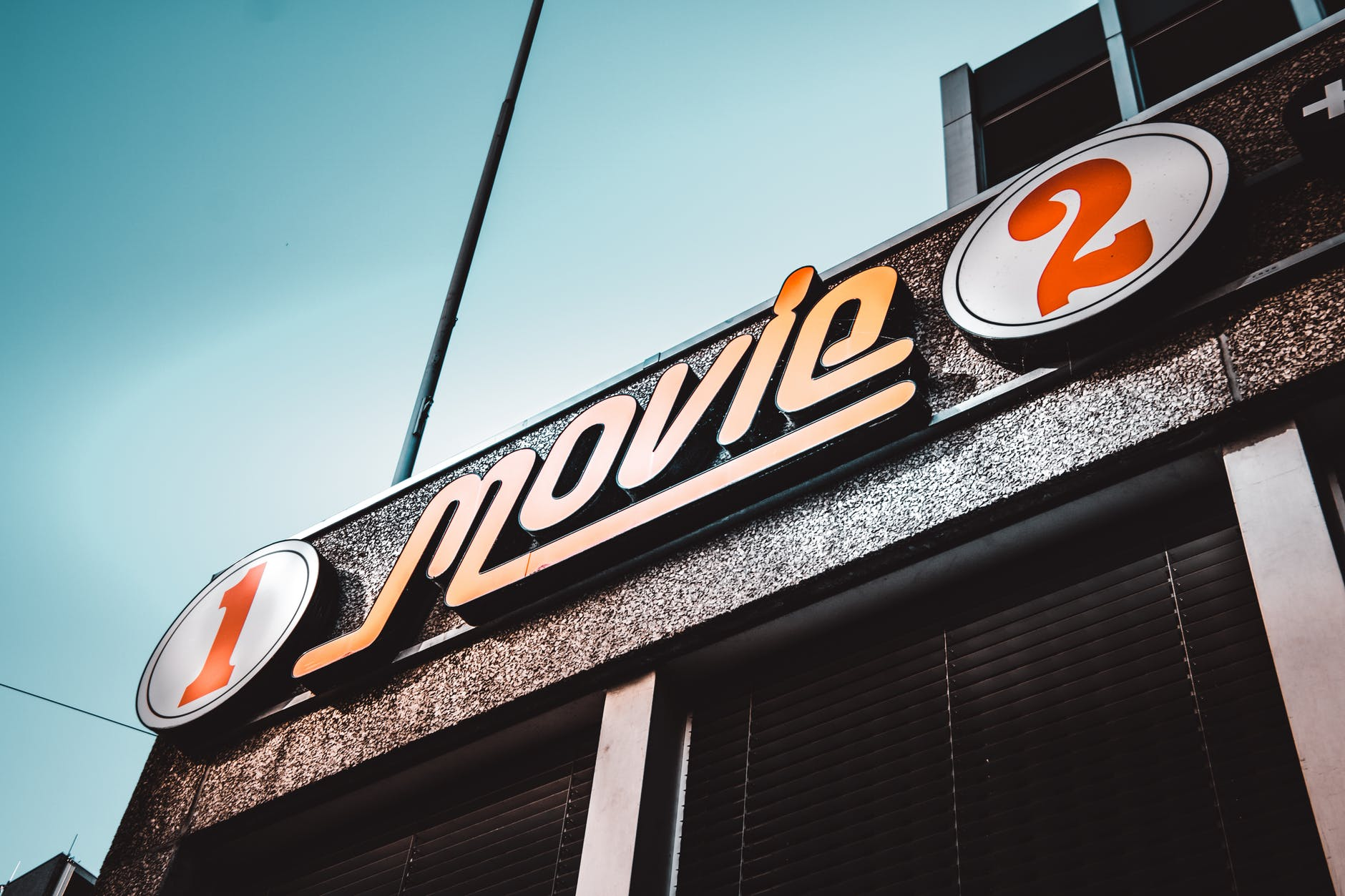 the entrance to a movie theater with a sign saying MOVIE