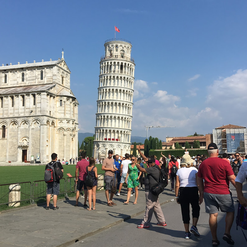 The Leaning Tower of Pisa with tourists swarming around
