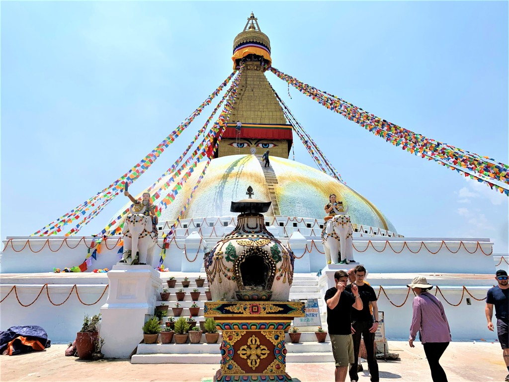 Boudhanath Stupa with little flags fluttering in the wind.