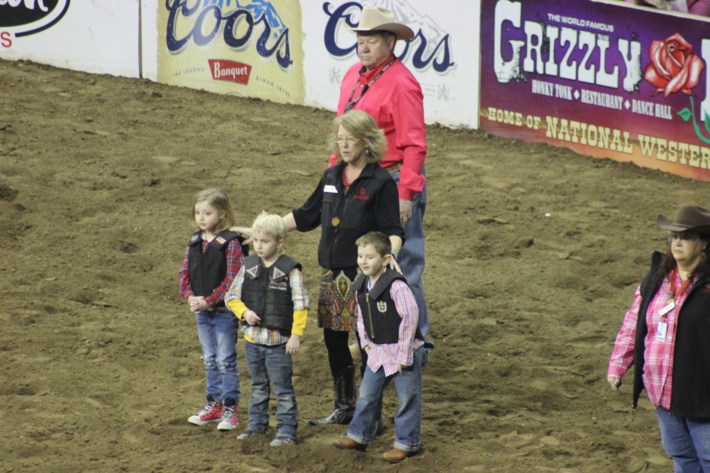 three kids of about 8-9 yrs old waiting to compete in the rodeo