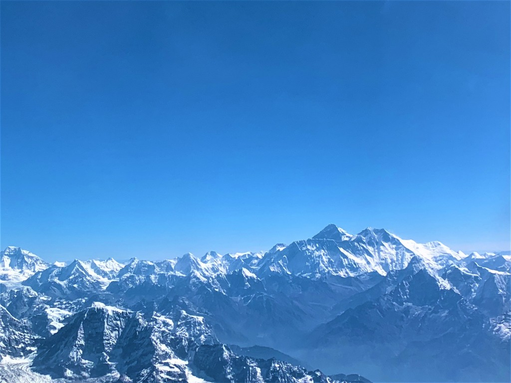 Mt Everest and the Himalalyan range while flying in a plane from 7000 ft
