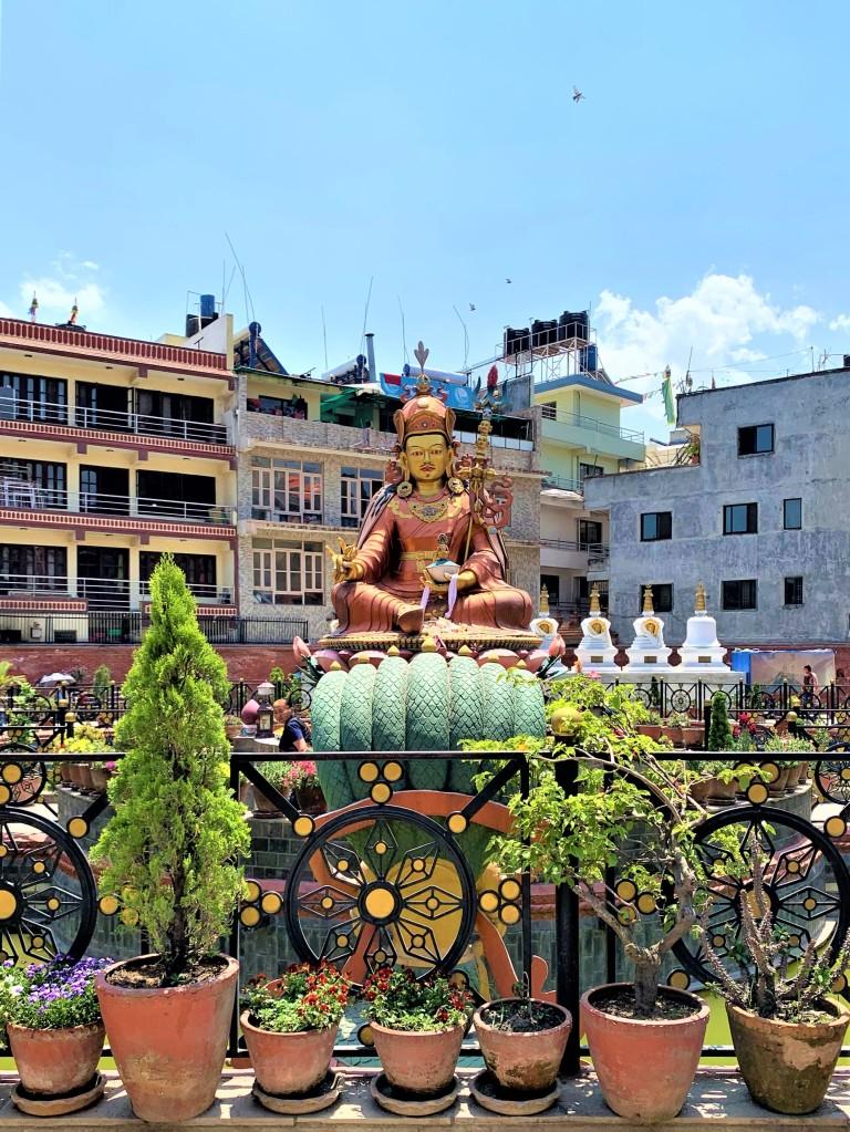Budha idol in a garden near Bodhanath Stupa
