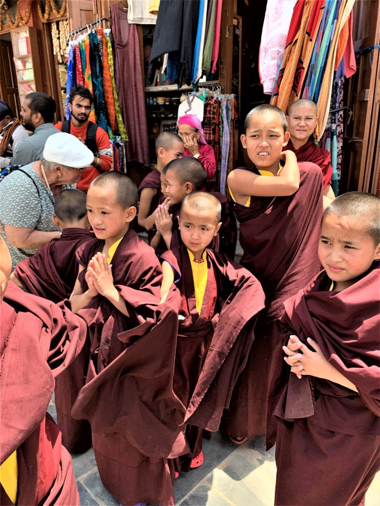 Little boys of about 10 years old wearing the robe of monks at Boudhanath Stupa