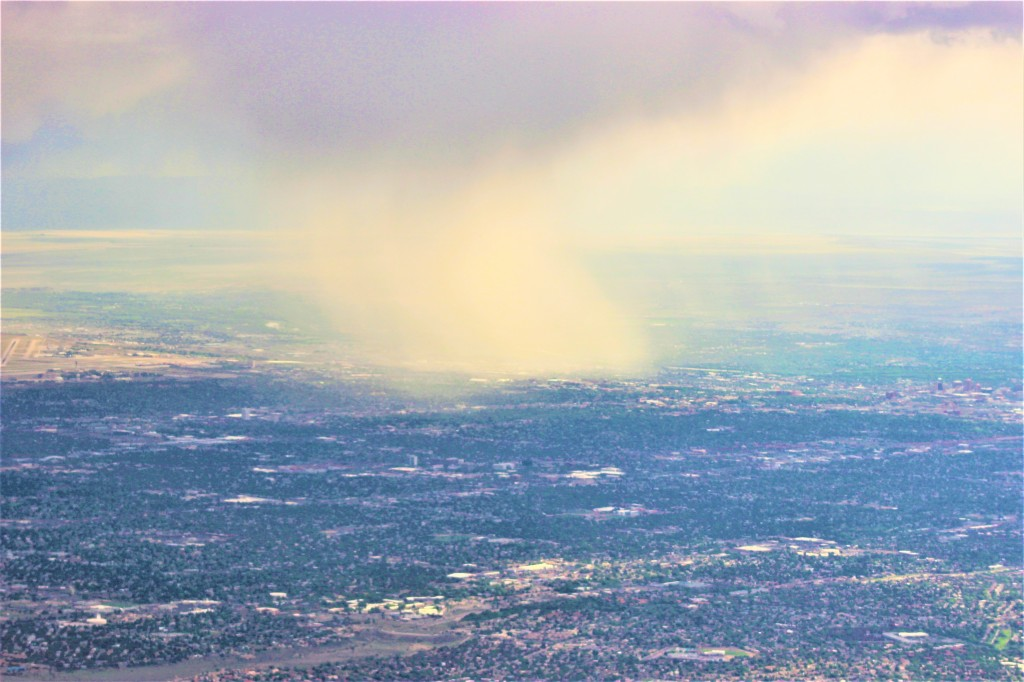 a cloud burst over a portion of the city of Albuquerque seen from Sandia Peak