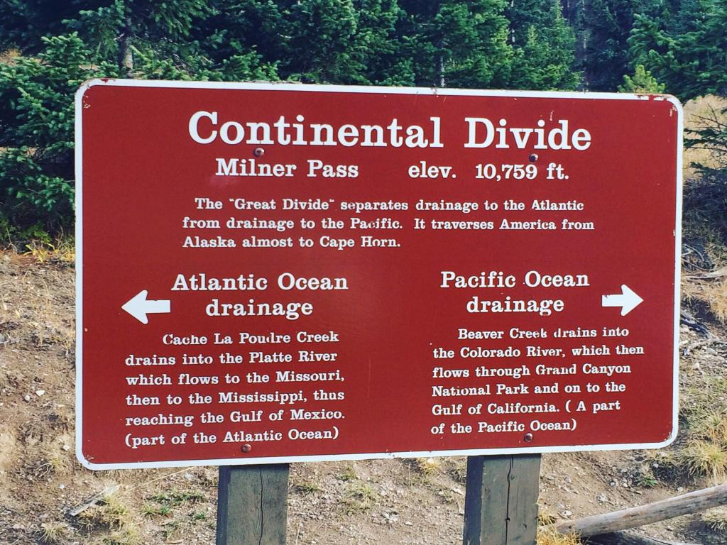 Signage showing the continental divide at Milner Pass.