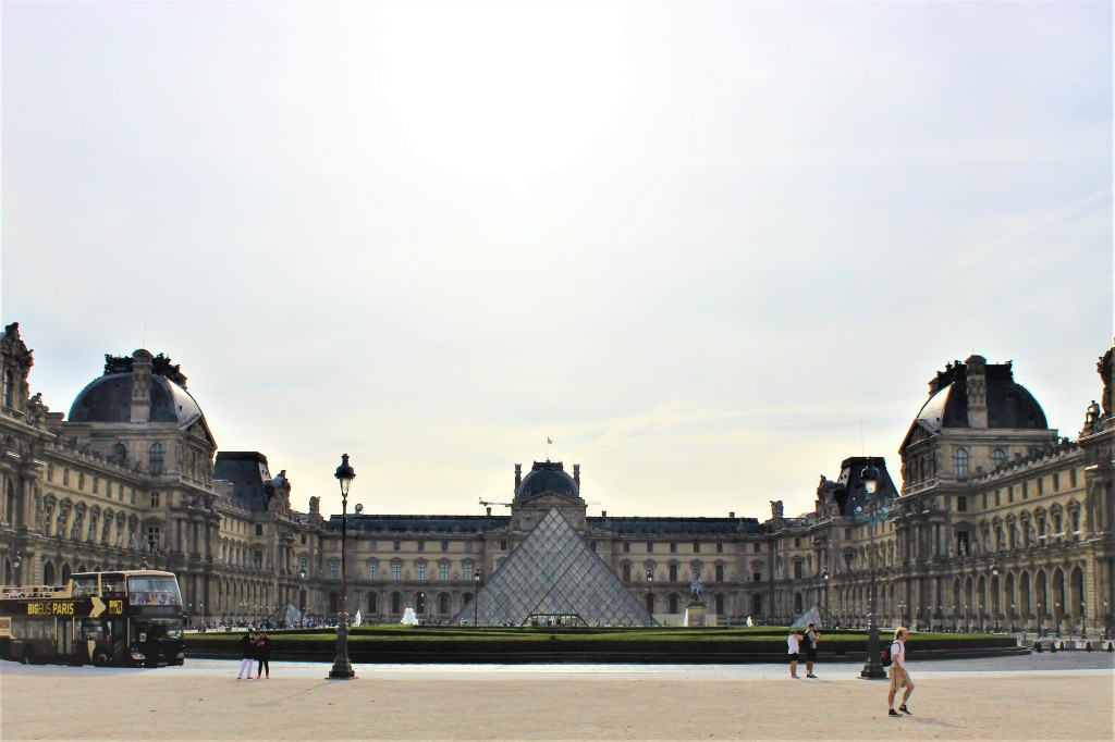 The Louvre Museum with the sun rising in the back
