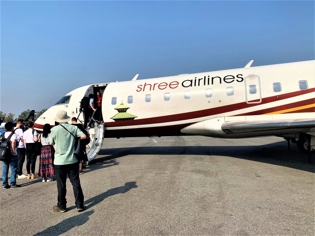 Shree airlines plane waiting to takeoff on a flight over the himalayas.