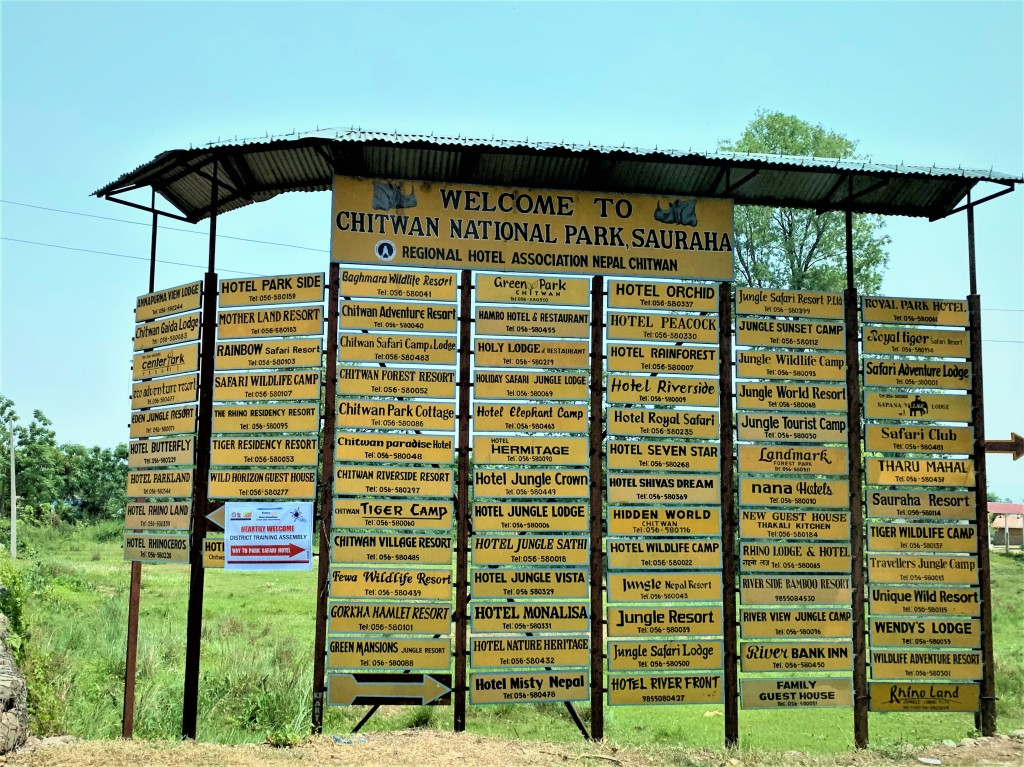 signboard with names of hotels and resorts in chitwan