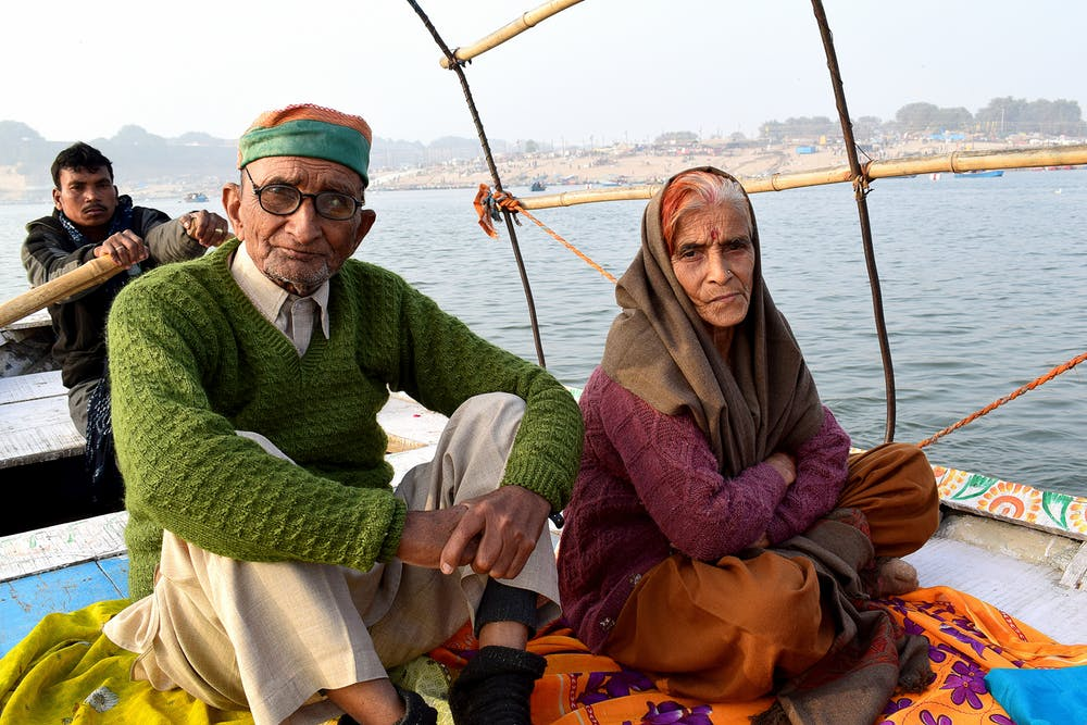 an old couple on a boat not smiling