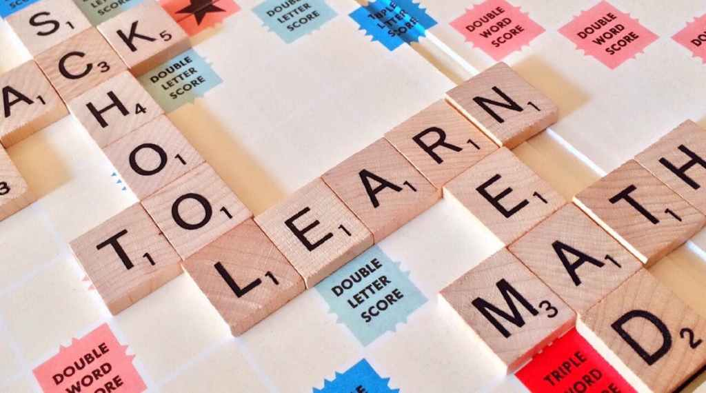 a scrabble board with the tiles reading school and learning and math and read  Blogchatter Half Marathon The Need to Update