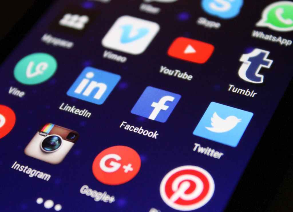 a mobile phone with social media apps like instagram, facebook, twitter, Pinterest, Google+ visible - promote your blog