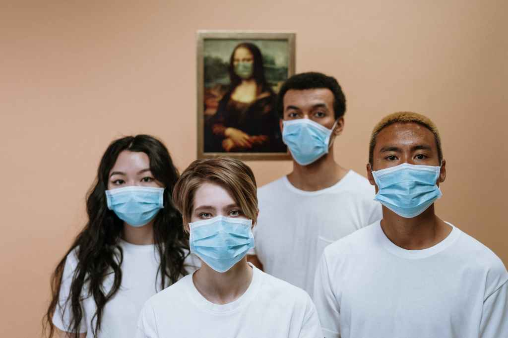 four people in masks on being authentic in time of covid 19